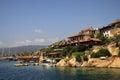 Turkish village on the rocks at Mediterranean sea shore