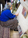 Turkish woman making a carpet hand woven in factory cooperative antalya turkey Stock Images