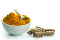 Turmeric bowl of powder with fresh root Royalty Free Stock Image