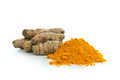 Turmeric pile of powder with fresh root Stock Image
