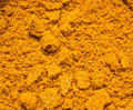 Turmeric powder close up background Stock Photo
