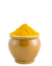 Turmeric powder ii in a ceramic container over white background Royalty Free Stock Image