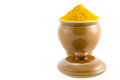 Turmeric powder iii in a ceramic container over white background Royalty Free Stock Images
