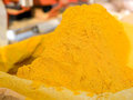 Turmeric powder spice pile Stock Images