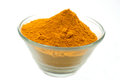 Turmeric powder spices pile of yellow over white Stock Photography