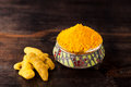 Turmeric powder and turmeric sticks Stock Photography