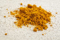 Turmeric powder on a white painted rough barn wood surface Royalty Free Stock Photo