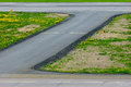 The turn of the airport landing runway road with painted white yellow horizontal signals and lights in pulkovo international Stock Photos
