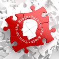 Turn on the brain red puzzle written arround human head icon Stock Image