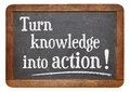 Turn knowledge into action motivational advice on a vintage slate blackboard Royalty Free Stock Image