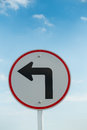 Turn left traffic sign on skies background, Sign & Symbol. Royalty Free Stock Photo