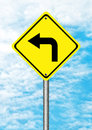 Turn left yellow traffic sign on blue sky Stock Photos