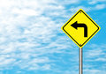 Turn left yellow traffic sign on blue sky blank for text Stock Photos