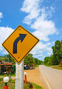 Turn right sign and street asphalt in rural area Royalty Free Stock Photography