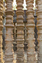 Turned stone bars of a window at the Khmer temple of Angkor Wat Royalty Free Stock Photo