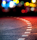 Turning asphalt road with marking lines and lights Stock Image