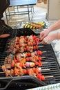 Turning Kebab Skewers On The BBQ