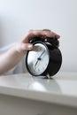 Turning off alarm clock Royalty Free Stock Photo