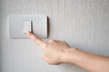 Turning on or off on light switch Royalty Free Stock Photo