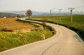 Turning on a small road in sunset rural landscape Royalty Free Stock Photo