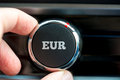 Turning up a dial with the word eur hand of man Stock Photography