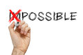 Turning the word impossible into possible on whiteboard Royalty Free Stock Photo
