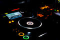 Turntable and LP vinyl record on a DJ music deck Royalty Free Stock Photo