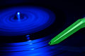 Turntable in motion a record that moves blue Royalty Free Stock Photo