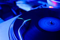 Turntable in motion a record that moves blue Royalty Free Stock Image