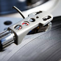 Turntable playing vinyl record with music player musical useful for dj nightclub and retro theme Stock Photos