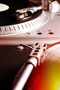 Turntable playing vinyl record with music player musical useful for dj nightclub and retro theme Stock Images