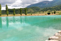 Turqouise water lake drï me france turquoise in mountainous landscape and under cloudy sky Stock Image