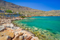 Turquise water mirabello bay plaka town crete greece Stock Photography