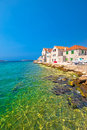 Turquoise beach and stone waterfront in Prvic Sepurine Royalty Free Stock Photo
