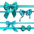 Turquoise and blue satin bows isolated on white.