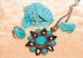 Turquoise gemstones with a pendant and ring with polished cabochons and a specimen of massive natural stone used by ancient Royalty Free Stock Photos