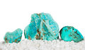 Turquoise the master healing stone polished and rough which relieves stress and derives its blue colour from copper making it Royalty Free Stock Image