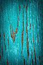 Turquoise peeled paint a detailed close up macro photograph of on a wood substrate a great texture image for a background or Stock Photography