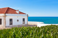 Turquoise sea blue sky and white house in portugal view from lighthouse Stock Photography