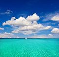 Turquoise sea water and cloudy blue sky paradise island holiday background with Stock Images