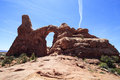 Turret Arch and Contrail, Arches National park, Utah, USA Royalty Free Stock Photo