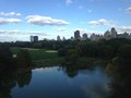 Turtle Pond and Great Lawn in the Fall in front of Belvedere Castle in Central Park, Manhattan. Royalty Free Stock Photo