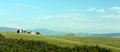 Tuscan chapel panorama panoramic view on the hills near pienza with small on rolling hills Stock Photo