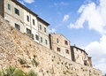 Tuscan cliff side houses on a in pienza italy Stock Images
