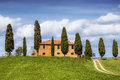 Tuscan landscape with farmhouse and cypress trees Royalty Free Stock Photo