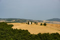 Tuscan landscape with a little church at the horizon surronded b Royalty Free Stock Photo