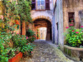 Tuscan lane arched cobblestone street in a village italy Royalty Free Stock Photos