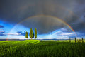 Tuscan rainbow typical landscape in the orcia valley with a group of cypress trees surrounded by a double Stock Photos