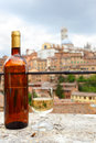 Tuscan white wine glass and bottle of local siena italy Stock Photography