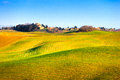 Tuscany crete senesi green fields italy country landscape europe rolling hills with shadows and sunlight blue sky partially cloudy Stock Photography